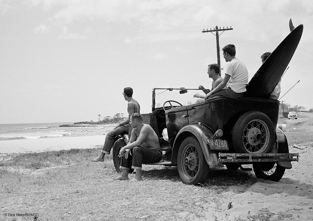 "Dick Metz, Al Weimers, Herb Nolan and a couple of locals survey the potential of Makaha on the west side of Oahu from Metz's Model A ""bathtub"" jalopy circa 1954. Photo: Dick Metz Collection/SHACC."