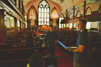 Director Brian Ivie (left) and producer Mike Wildt (right) inside Mother Emanuel AME Church, where they filmed several interviews for the documentary. Courtesy of Steven Siwek
