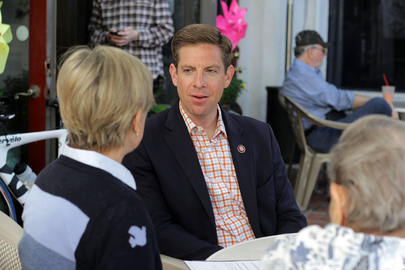 Congressman Mike Levin sits down for a cup of coffee with Dana Point resident Maureen Goldsmith at Café Calypso in San Clemente on Wednesday, May 29. Photo: Shawn Raymundo