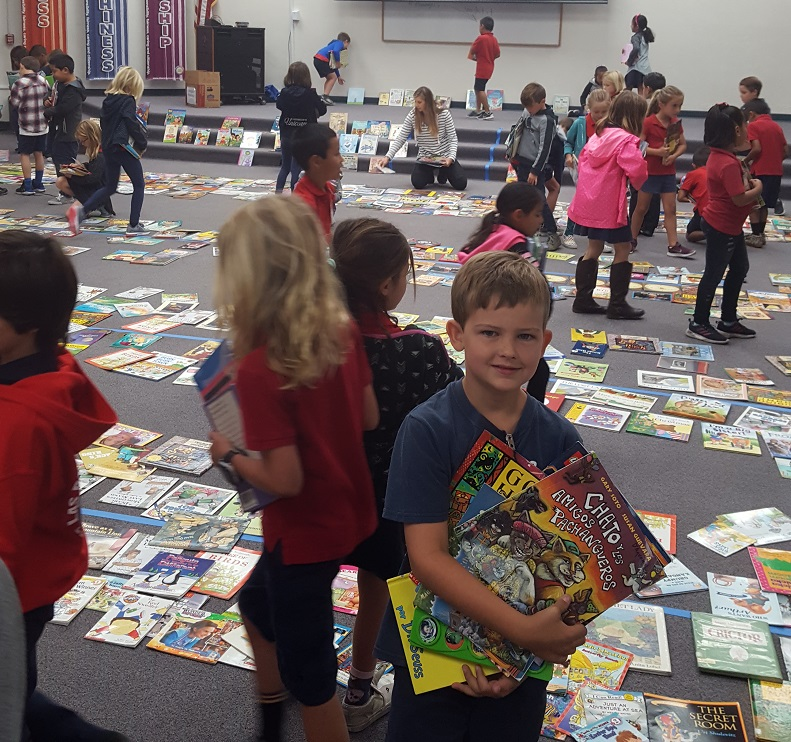 Malcolm Wiechman collects his books at the Las Palmas Elementary spring book drive. Photo Courtesy of Las Palmas