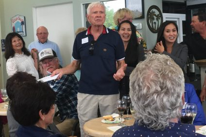 Tom Blake speaks at a recent meet-and-greet event at Tutor and Spunky's Deli in Dana Point. Photo: Jackie Hammond.