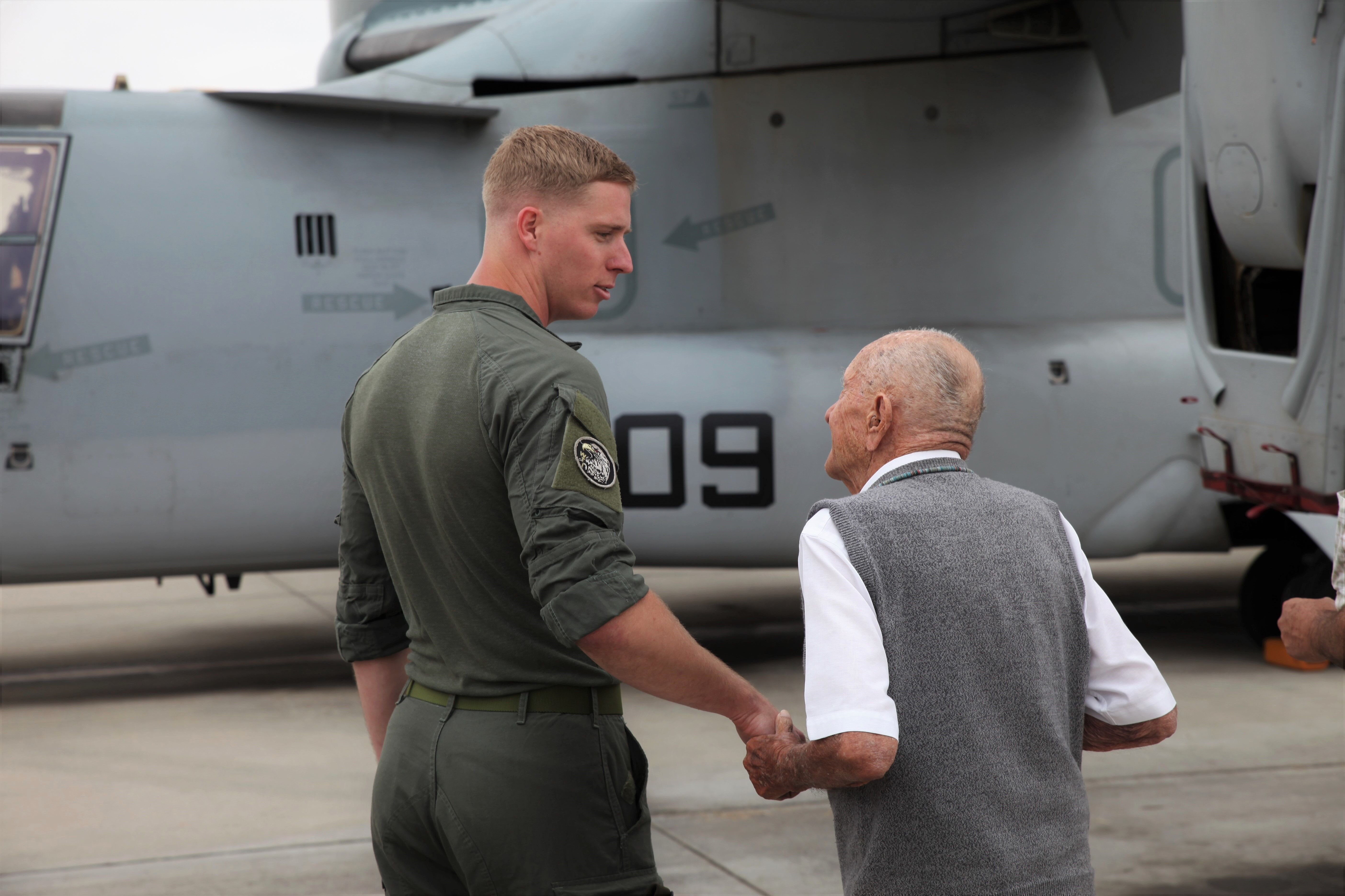 """Marine Medium Tiltrotor Squadron (VMM) 164, 3rd Marine Aircraft Wing Sgt. Brian Anderson escorts Maj. Richard """"Dick"""" Cropley (USMC, Retired) to a private tour of an MV-22B Osprey assault support aircraft on Friday, May 31 at Camp Pendleton. Photo: Adam Gilles"""