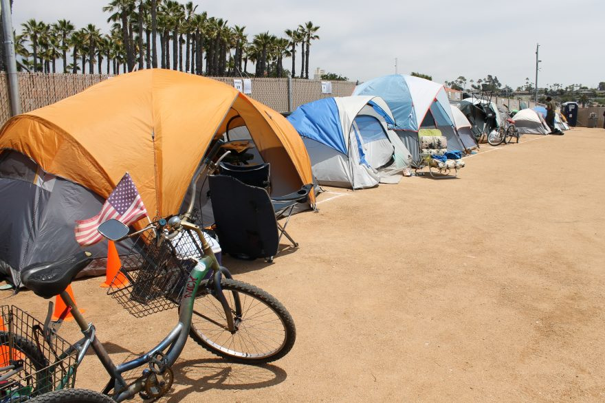 Tents line the fence along the homeless encampment on Avenida Pico in San Clemente, where the city has permitted people to camp. Campers have filled more than 24 spaces at the site.  Photo: Cari Hachmann