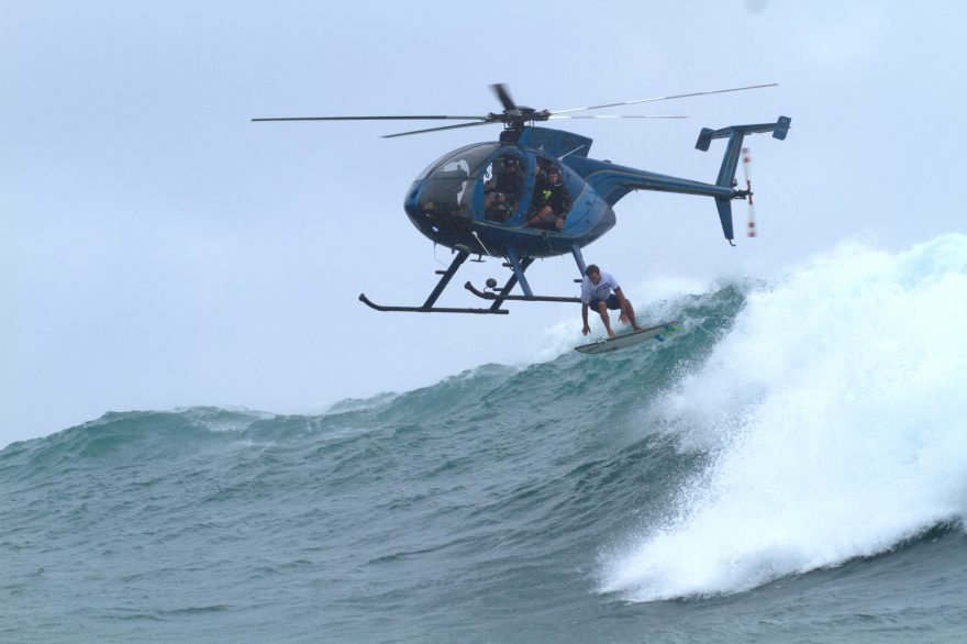 There aren't many people who relish the opportunity to jump out of a helicopter into giant surf; Nathan Fletcher is one of them. Photo: Hank/Heavy Water
