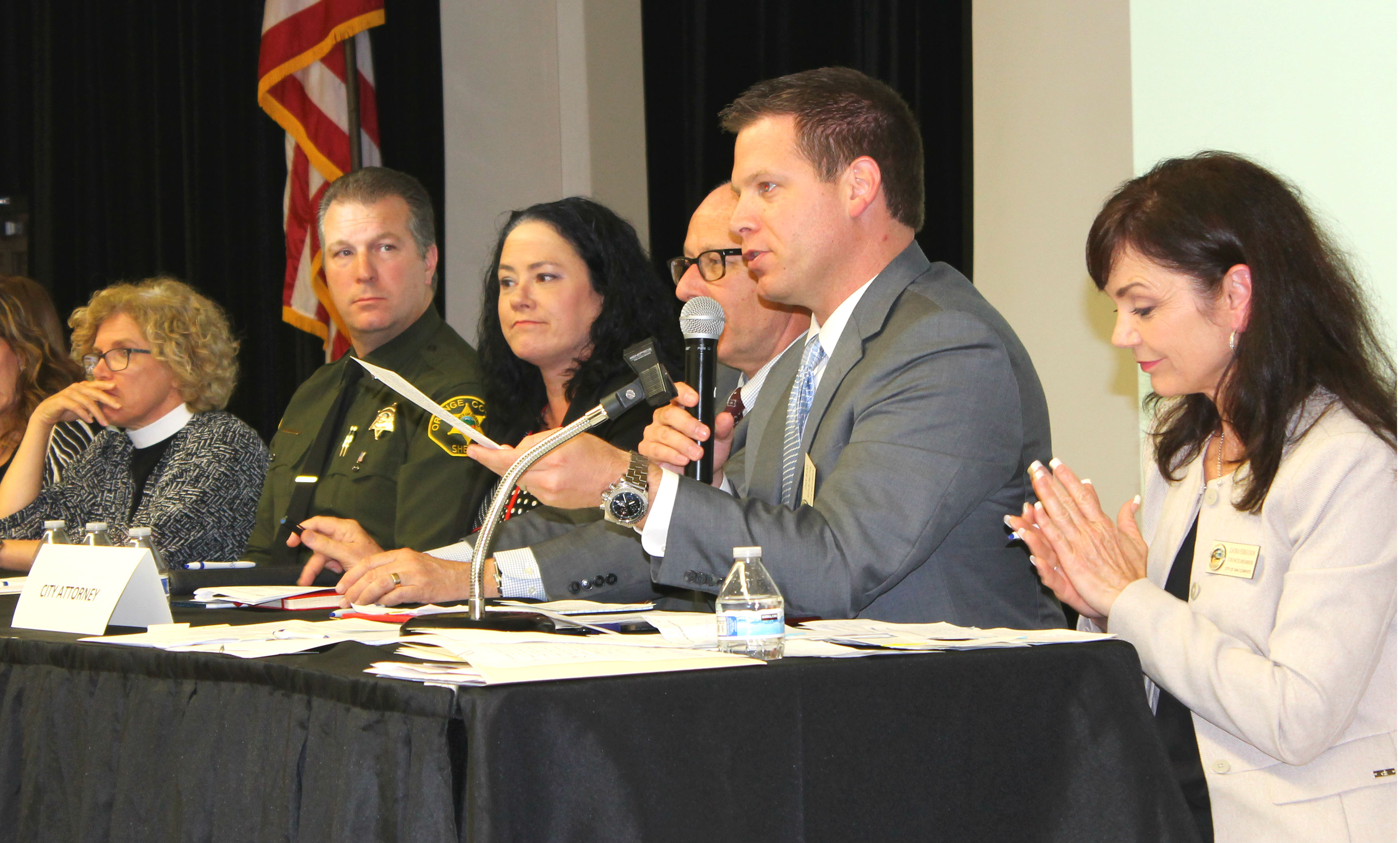 Panelists deliver individual presentations at a Town Hall meeting in San Clemente on June 13, and take questions from a roomful of residents on the topic of homelessness. Photo: Cari Hachmann