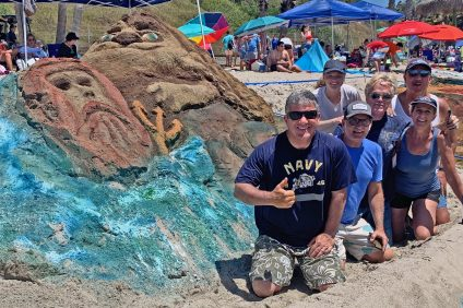 The Alessandro Sand Sculptors created this prize-winning entry at the 2019 San Clemente Ocean Festival, uniting The Lion King with King Neptune. Photo: Fred Swegles