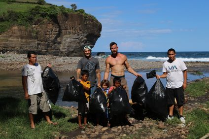 Shon Miller, 32, and Joshua Host, 37, of San Clemente, have taken their Beach Conservation Program all over the world, including El Salvador, where they are currently hosting beach cleanups with the local community and teaching kids how to take care of the environment. Photo: Daniel Gonzales