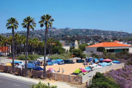 Homeless campers go about their day at the city-owned Pico lot. Meanwhile, lawyers for San Clemente and homeless advocacy groups battle in court over the camp's conditions. Photo: Adam Gilles