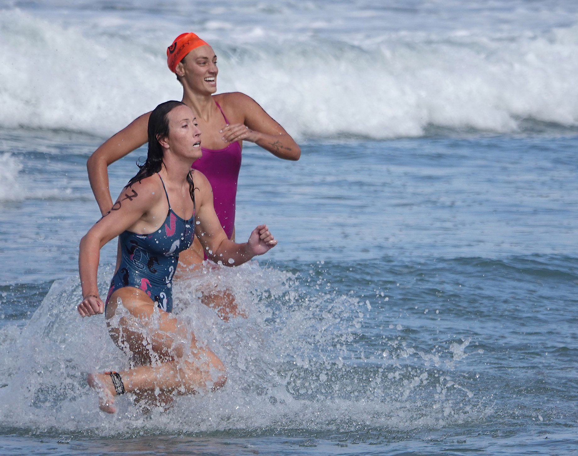Competitors dash for the shoreline in a surf race at the San Clemente Ocean Festival. Photo: Fred Swegles