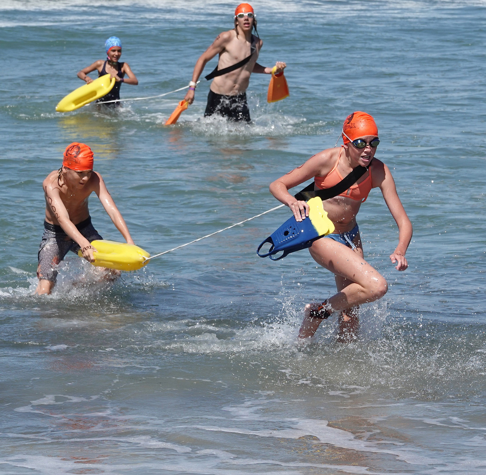 San Clemente junior lifeguards show their skills in a lifeguard surf rescue relay race at the San Clemente Ocean Festival. Photo: Fred Swegles
