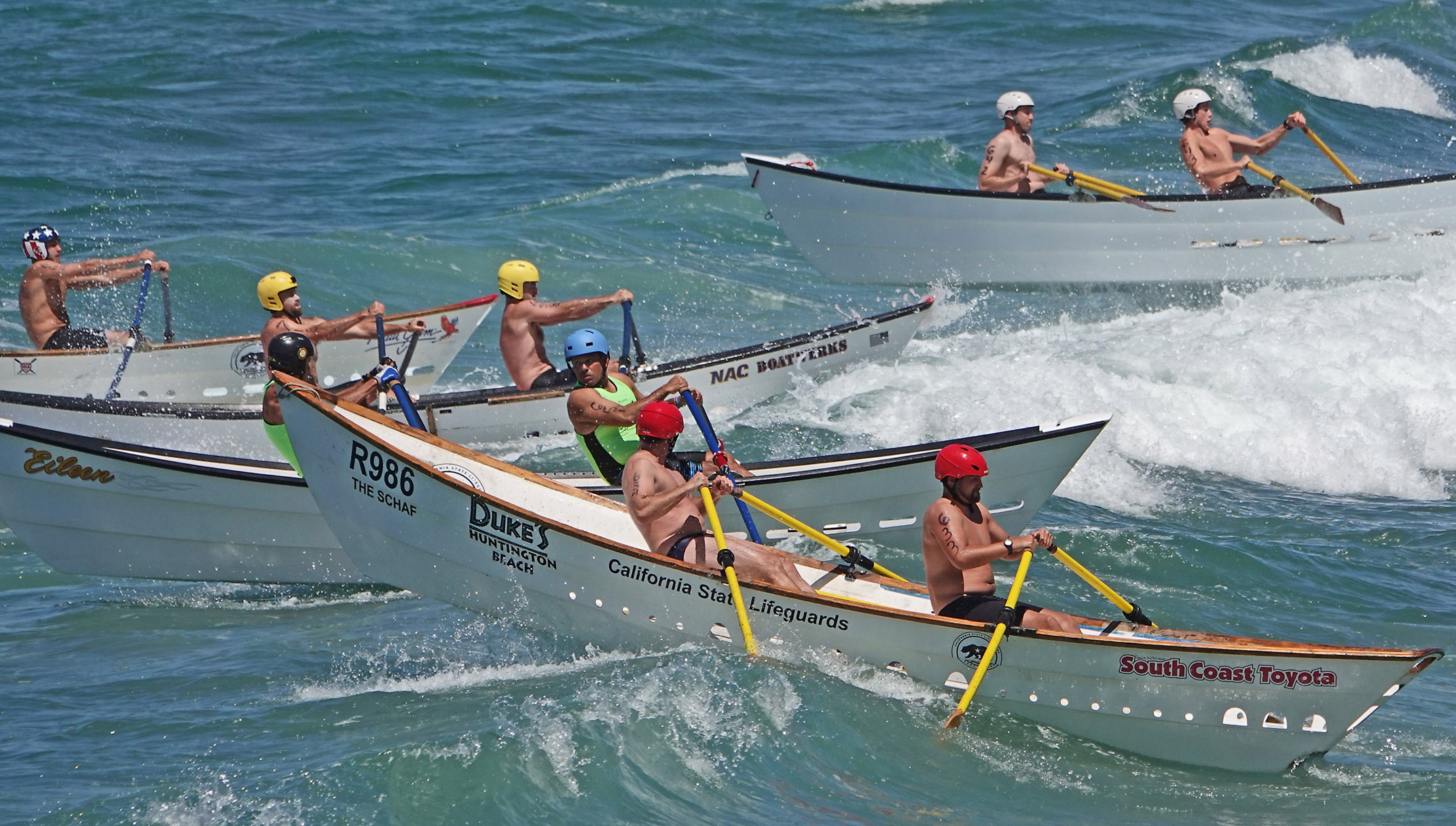 Surf boats, known as dories, try to avoid each other while rowers negotiate the surf at the San Clemente Ocean Festival. Photo: Fred Swegles