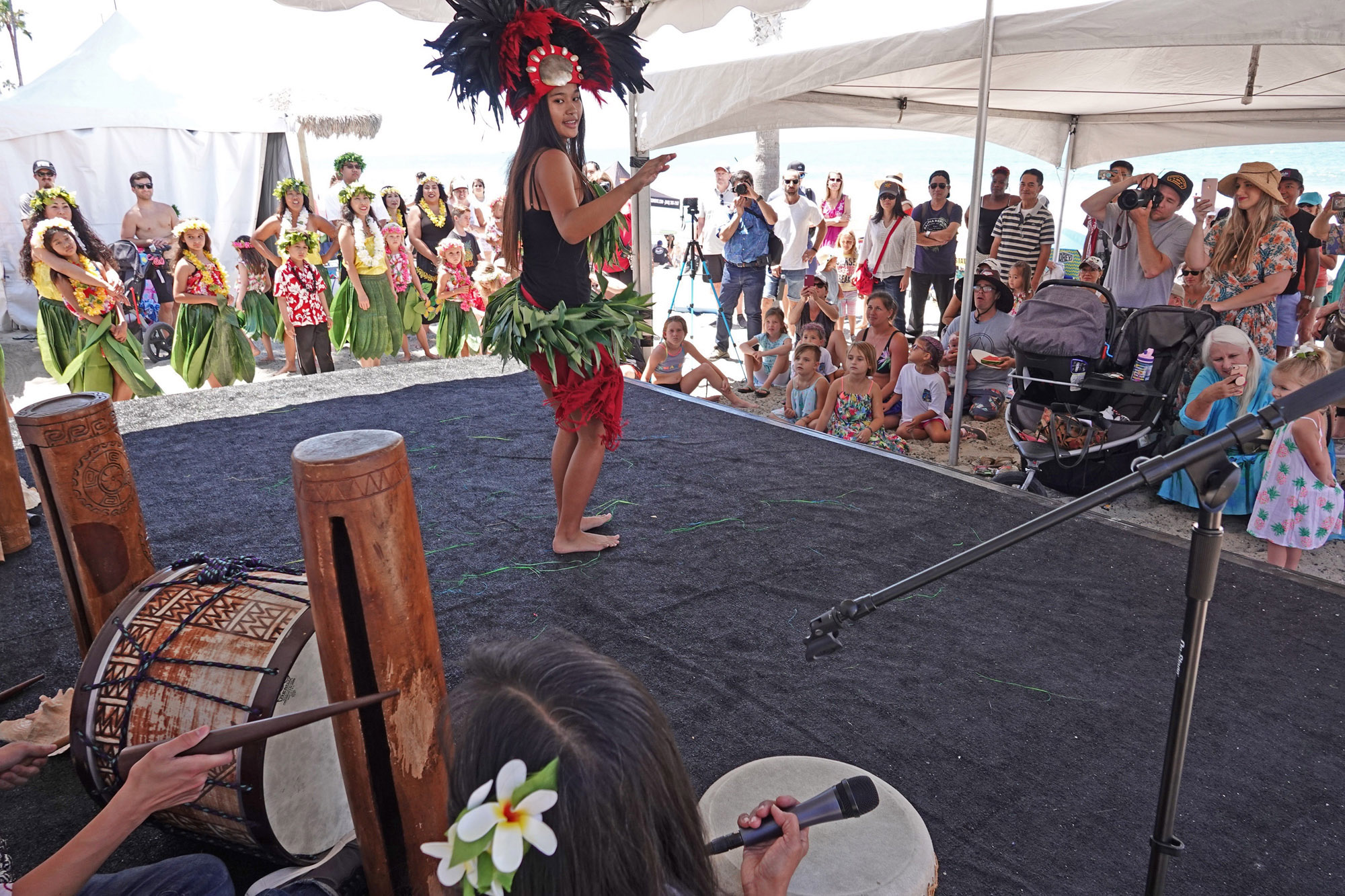 Amanda Cabagbag of San Clemente turns to sync with Hula Connection's percussionists to perform a Tahitian dance at the San Clemente Ocean Festival. Photo: Fred Swegles