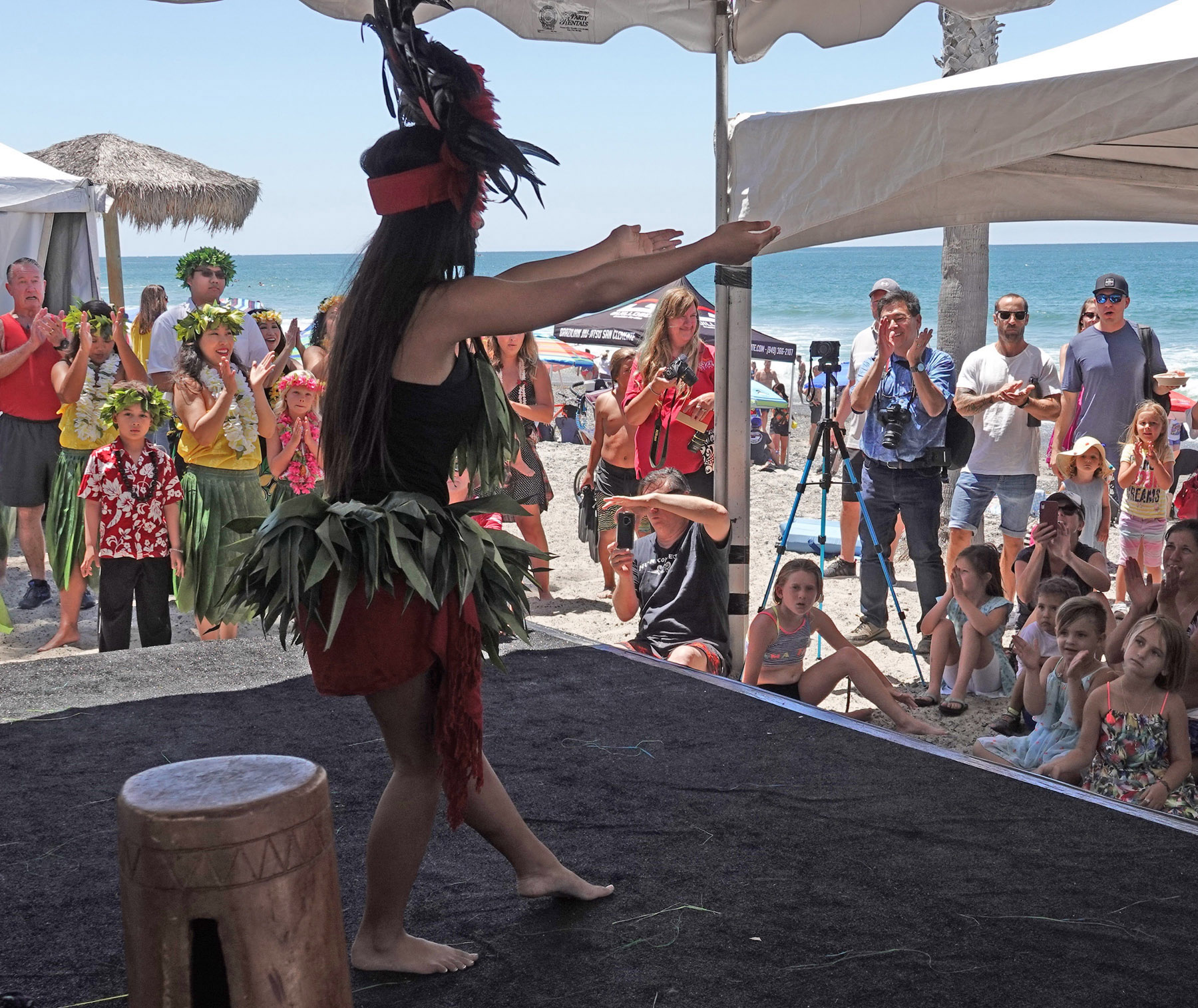 The audience applauds San Clemente's Amanda Cabagbag as she and the troupe Hula Connection demonstrate Tahitian dance at the San Clemente Ocean Festival. Photo: Fred Swegles