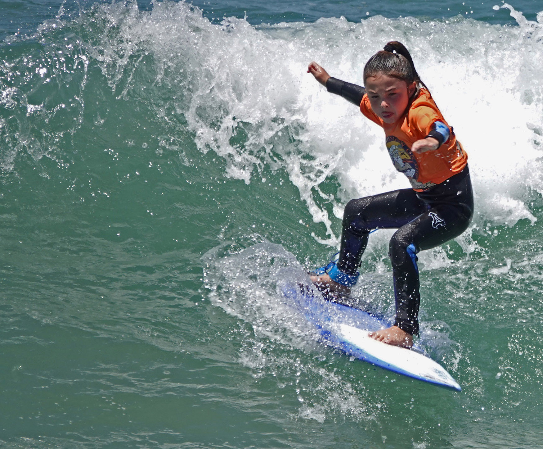 Pushed into a wave by her dad, Reese Shigei powers a cutback during a 'Groms Rule' surf contest at the San Clemente Ocean Festival. Photo: Fred Swegles