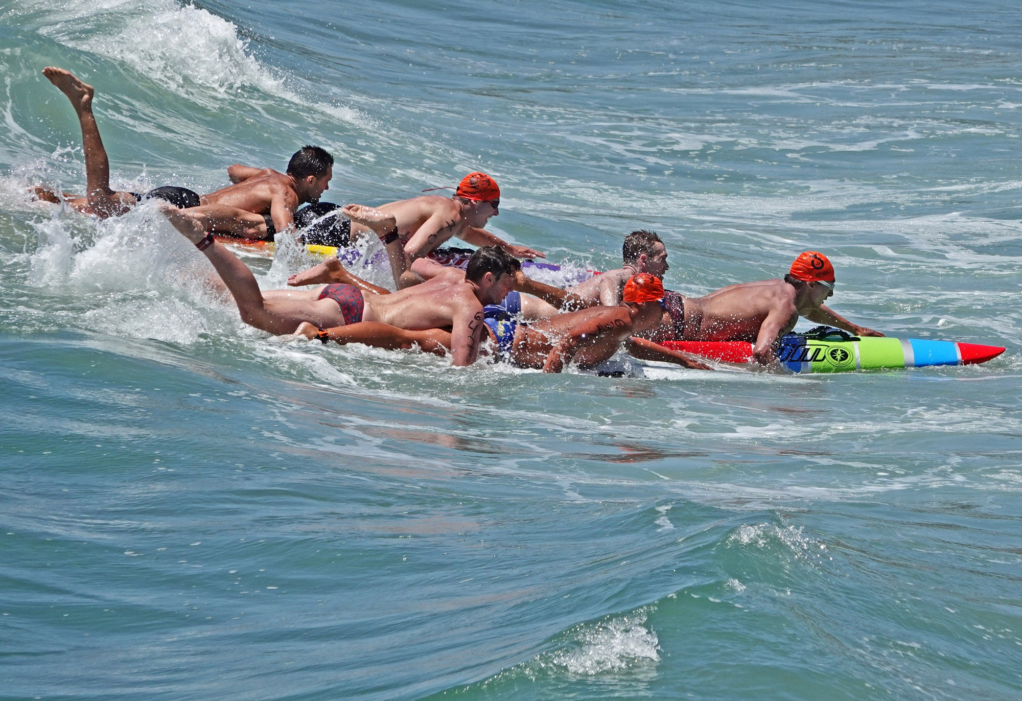 Three two-man paddle teams appear to be knotted up as they race for the finish line.' Photo: Fred Swegles