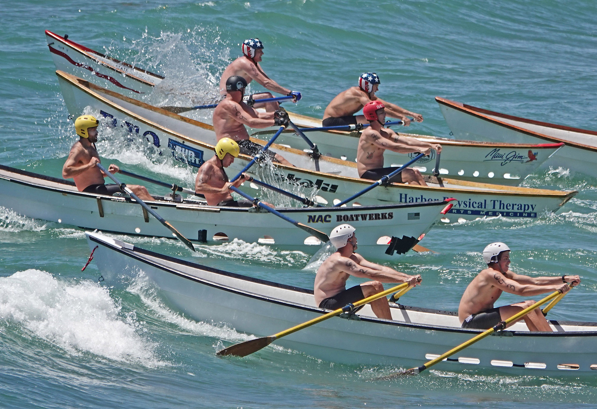 Which dory team would emerge No. 1 at the 2019 San Clemente Ocean Festival? The guys in the red, white and blue helmets won both races, rowing San Clemente State Beach's boat. That's Dane Debour, left, and James Bray. Photo: Fred Swegles