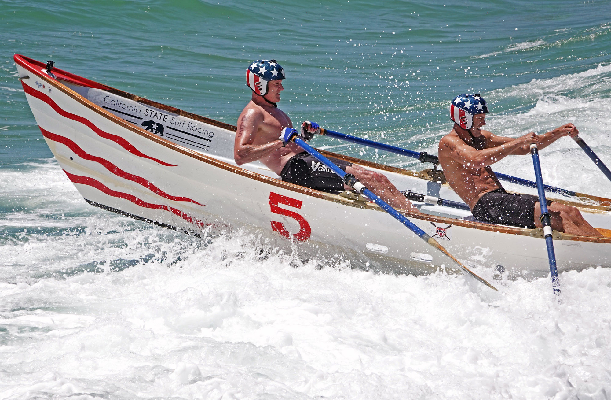 Dane Debour, left, and James Bray endeavor to increase their lead in a dory race at the 2019 San Clemente Ocean Festival. They won both races. Photo: Fred Swegles