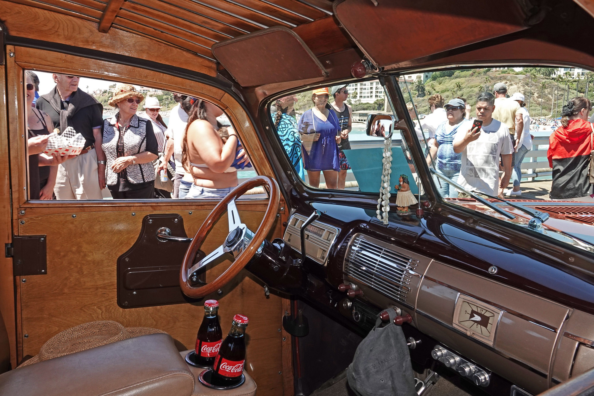 The Cokes are ready to roll, but the woodie sits empty, parked on the San Clemente Pier for the enjoyment of car lovers at the San Clemente Ocean Festival. Photo: Fred Swegles