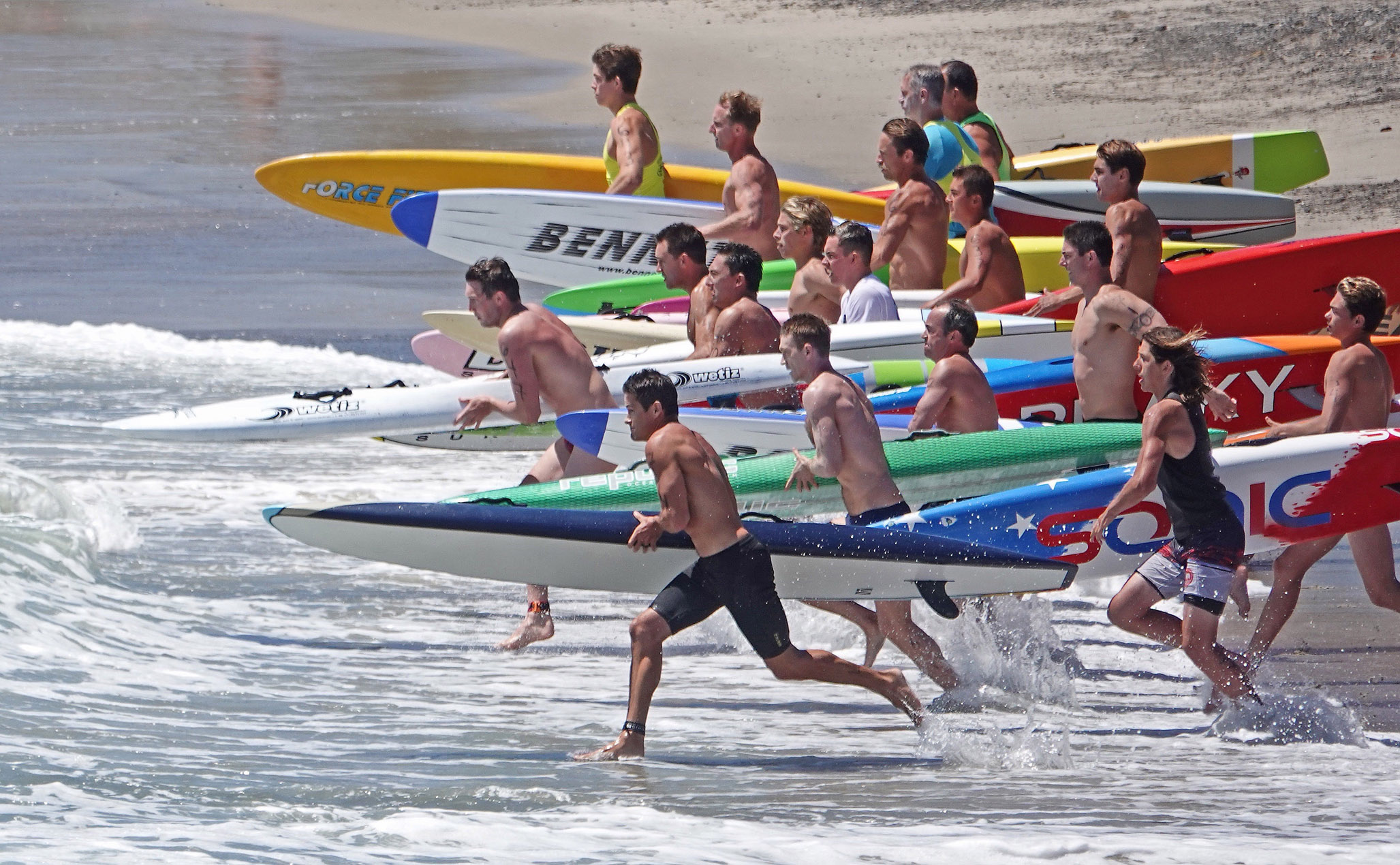 It's off and running for a paddle race at the San Clemente Ocean Festival, dubbed 'The Greatest Show on Surf.' Photo: Fred Swegles