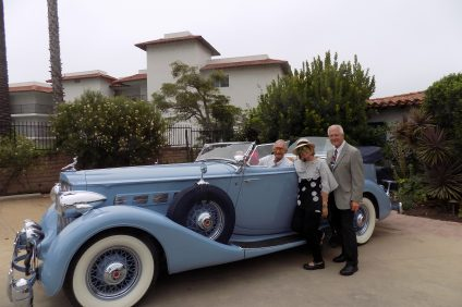 Casa Romantica docents Sandy Wheeler and Lou Leto pose with Earl Rubenstein, the proud owner of an elegant 1935 Packard Dual Cowl convertible as part of a Packard Club of San Diego parade that began at Casa and drove through San Clemente on Saturday, July 13. Photo by Lou Leto.