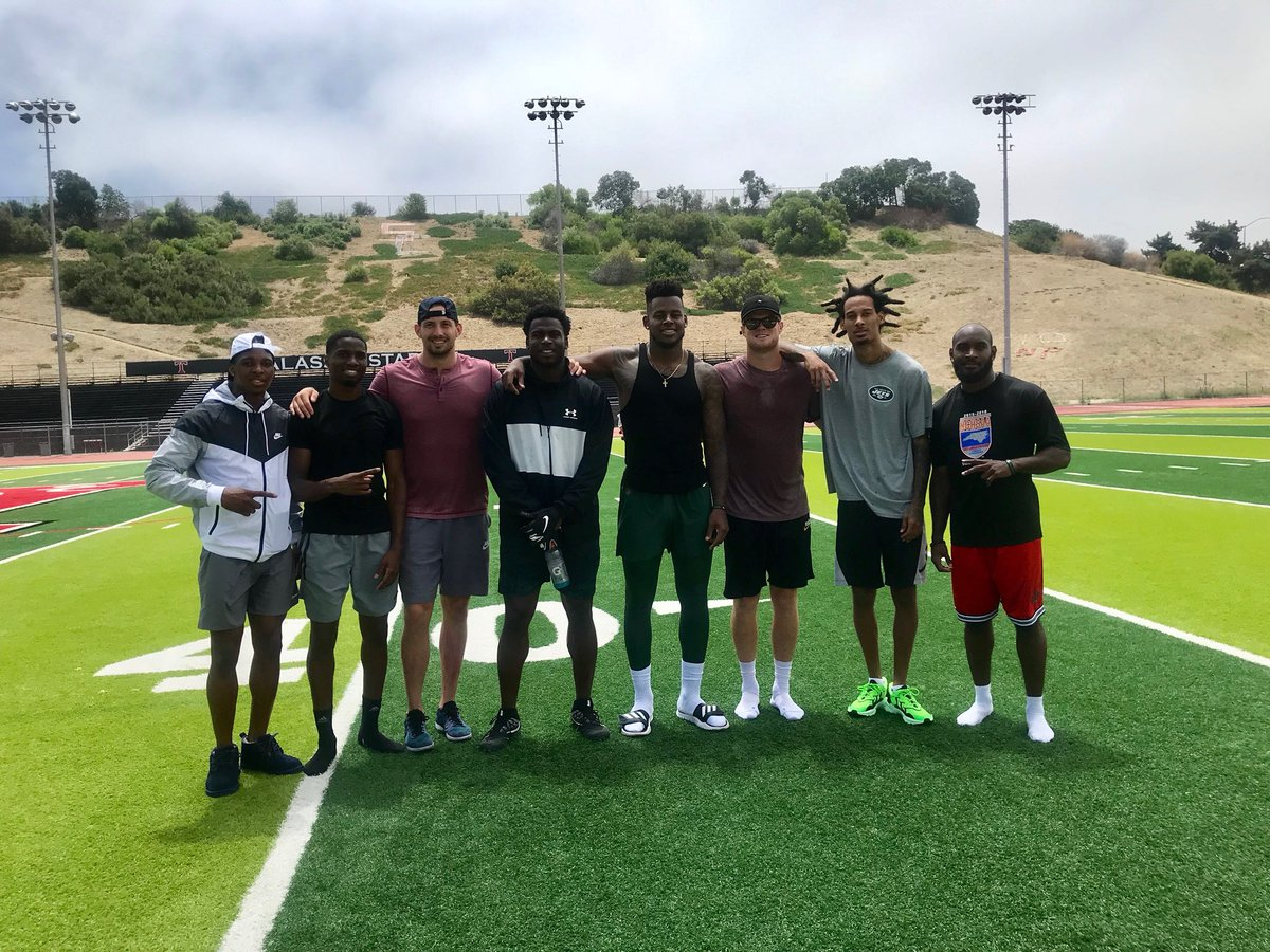 San Clemente alum and New York Jets quarterback Sam Darnold (third from right) hosted several teammates for offseason workouts at San Clemente High School. Photo: Courtesy of Triton Football.