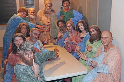 """Pageant of the Masters cast members point to San Clemente's Mark Brownell, seated second from left on the right side of the table, in a backstage reassembly of Leonardo da Vinci's masterpiece, """"The Last Supper."""""""