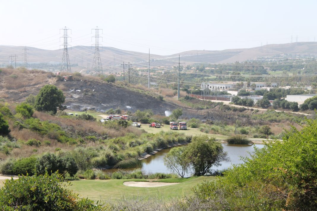 A brush fire started on a hillside near Bella Collina golf course in San Clemente on Wednesday, July 24. Photos: Cari Hachmann
