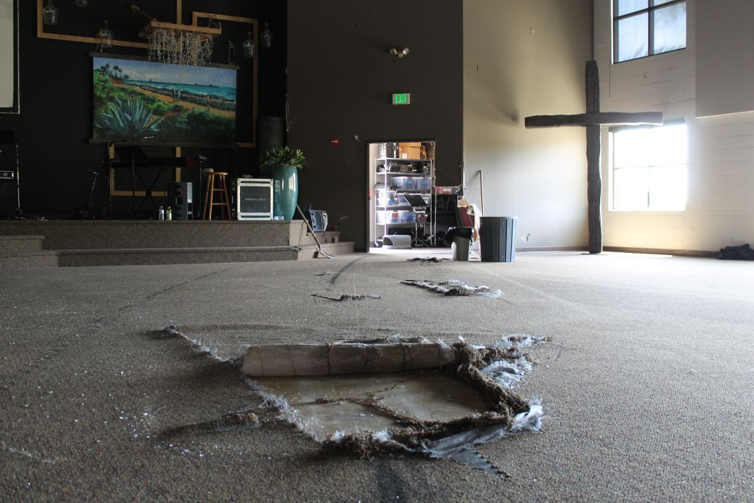 Carpet was torn up when the car accelerated into the main worship area of the church. Photo: Cari Hachmann