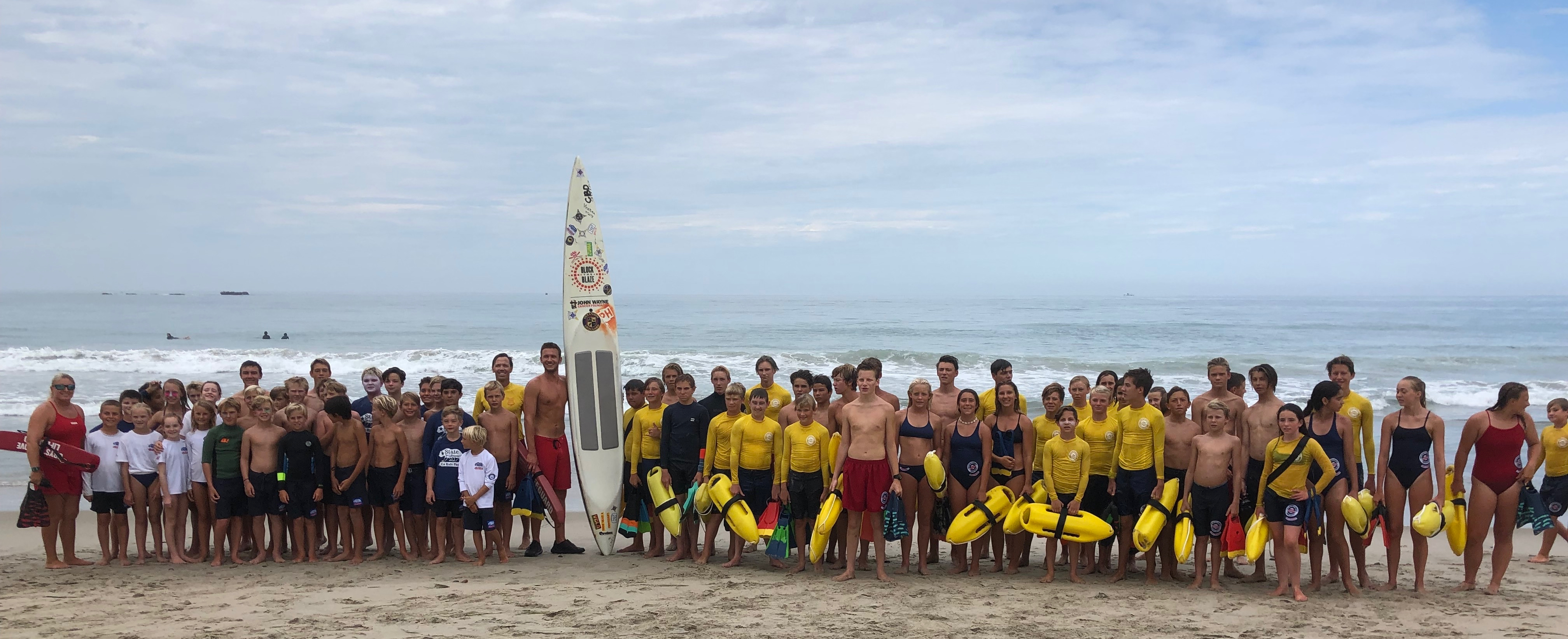 San Clemente Lifeguards and Junior Lifeguards took part in an ocean paddle on Thursday, July 25 as part of the SoCal PaddleDown For Cancer Relay, which promotes sun safety and skin cancer awareness among lifeguard agencies along the California coast. Photo credit CSLSA
