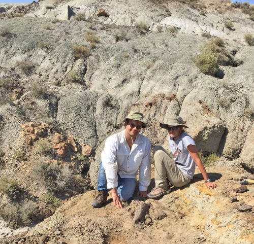 Clarissa Koos, pictured with a Triceratops horn, which turned out to be her first solo discovery of a fossilized dinosaur at a paleontology site in Montana in 2017. With her is Wolf Gordon Clifton, who accompanied her that day. Photo courtesy of Koos family